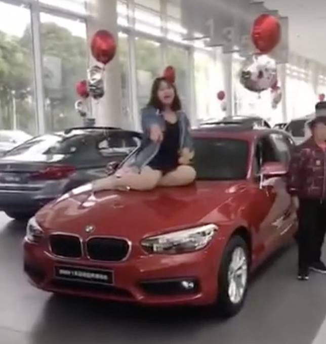 Police called in China after angry BMW owner protests in car showroom