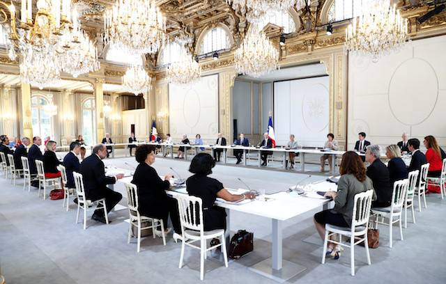 French President Emmanuel Macron, French Prime Minister Jean Castex and members of the new government attend their first minister council at the Elysee Palace in Paris, France, July 7, 2020.The French government said Wednesday it is preparing for a second wave of COVID-19 cases that could emerge in the coming months, but will not respond with another nationwide lockdown to contain the outbreak.