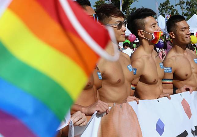 Thousands show up for pride parade on LGBT rights in Hong Kong, as some wear masks and chant anti-government protest slogans