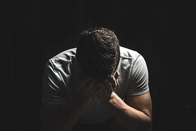 Ilustrasi laki-laki yang bersedih