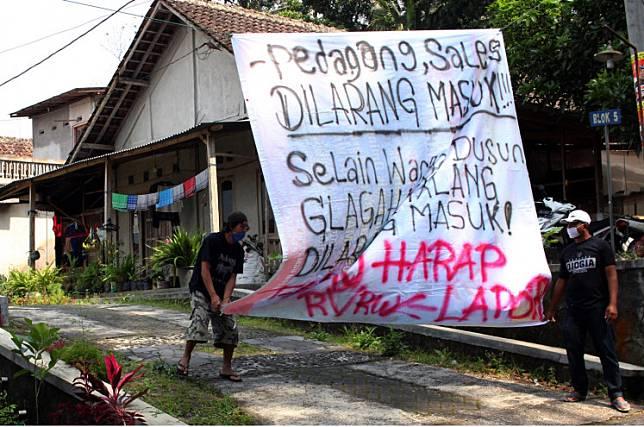 Residents of Srunen hamlet in Sleman regency, Yogyakarta, blocked off roads leading to their area on Saturday, March 28, 2020.