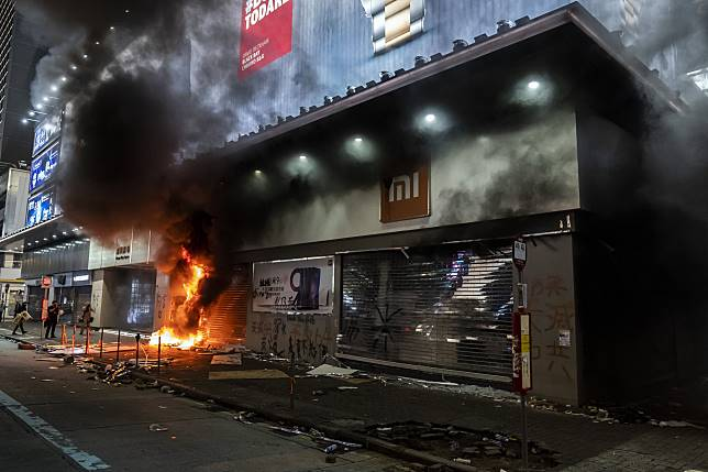 A Xiaomi store burns during a protest in the Mong Kok district of Hong Kong on Oct. 20. Photographer: Justin Chin/Bloomberg