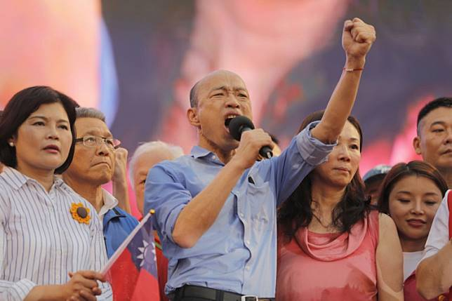 Kaohsiung city mayor Han Kuo-yu (C) from the Kuomintang party gestures while speaking to his supporters during a campaign event in Taipei on June 1, 2019.