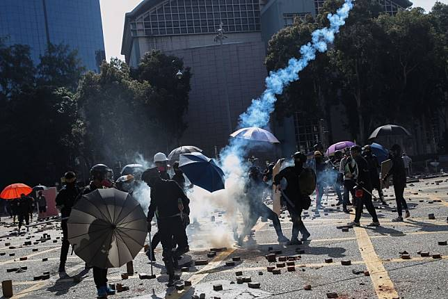 Hong Kong protests: all schools to remain closed on Monday as city braces for more traffic disruption, while tear gas is fired near Polytechnic University