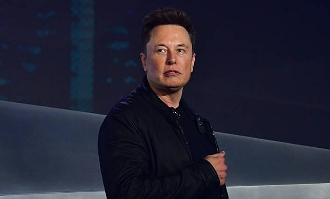 In this file photo taken on November 21, 2019 Tesla co-founder and CEO Elon Musk introduces the newly unveiled all-electric battery-powered Tesla Cybertruck at Tesla Design Center in Hawthorne, California.