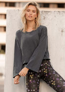 Designer Notes: This cropped long sleeve is the latest athleisure must have! With its raw edge detai