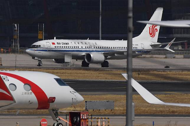 An Air China Boeing 737 MAX 8 plane is seen at Beijing Capital Airport on March 11, 2019. - China on March 11, 2019 ordered domestic airlines to suspend commercial operation of the Boeing 737 MAX 8, citing the Ethiopian Airlines crash and another deadly accident of that same model in Indonesia.