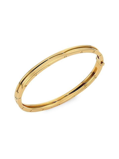From the B.zero1 Collection. Engraved logo elevates this striking gold bangle to a signature piece.;