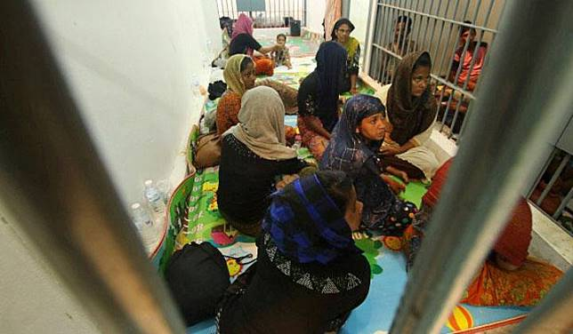 Rohingya people are seen detained in a police station after a fishing boat carrying more than sixty Rohingya refugees was found beached at Rawi island, part of Tarutao national park in the province of Satun, Thailand, bordering with Malaysia, June 12, 2019. REUTERS/Surapan Boonthanom
