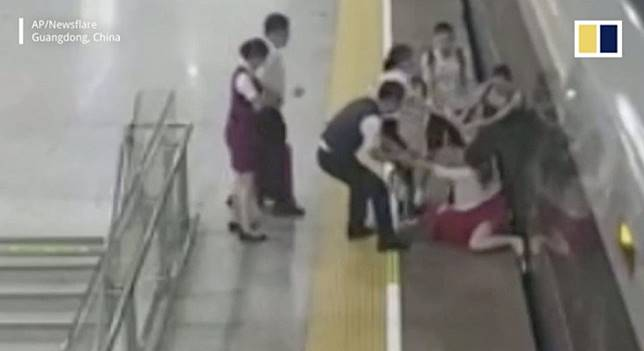 Chinese passenger who went off the rails after missing train detained for trying to stop it