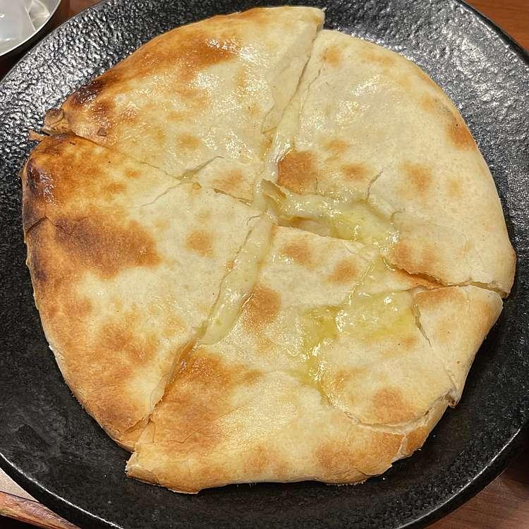 新宿区周辺で多くのユーザーに人気が高いインドカレースパイスバザール アチャカナのチーズクルチャの写真