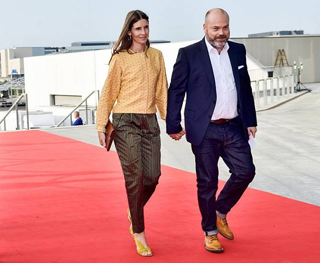 This picture taken on May 27, 2018 shows Bestseller-owner Anders Holch Povlsen and his wife Anne Holch Povlsen as they arrive at the celebration of the 50th birthday of Crown Prince Frederik of Denmark in Royal Arena in Copenhagen, Denmark. The Bestseller company confirmed on April 22, 2019, that the Holch Povlsen couple lost three of their children in the attacks in Sri Lanka. The death toll from bomb blasts that ripped through churches and luxury hotels in Sri Lanka rose dramatically April 22 to 290 -- including dozens of foreigners -- as police announced new arrests over the country's worst attacks for more than a decade.