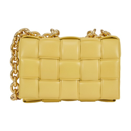 Worn using a large chain, the Intreccio nappa leather Chain Cassette bag by Bottega Veneta softens i