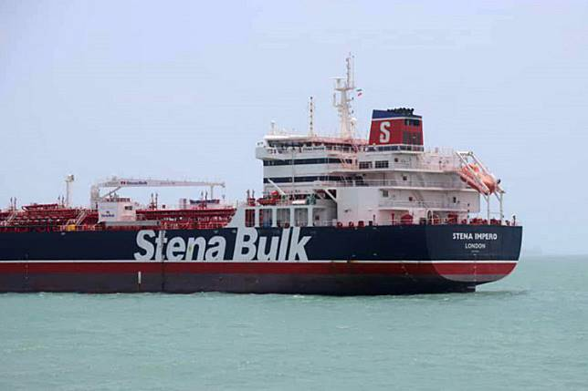 This handout picture released by Tasnim News Agency on July 20, 2019, shows British-flagged tanker Stena Impero anchored in Bandar Abbas in southern Iran. A British-flagged tanker seized by Iran is now at anchor off the port of Bandar Abbas with all its crew aboard after colliding with a fishing boat, authorities said on July 20. The Swedish-owned Stena Impero