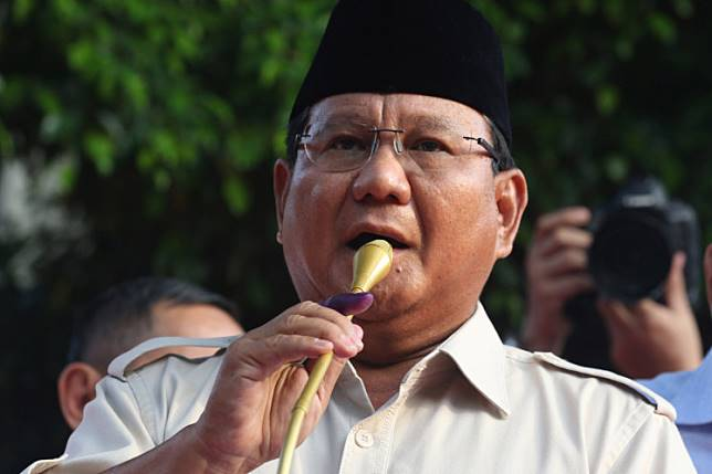 Prabowo Subianto holds a press conference following the release of election quick counts at his home in South Jakarta on April 17.
