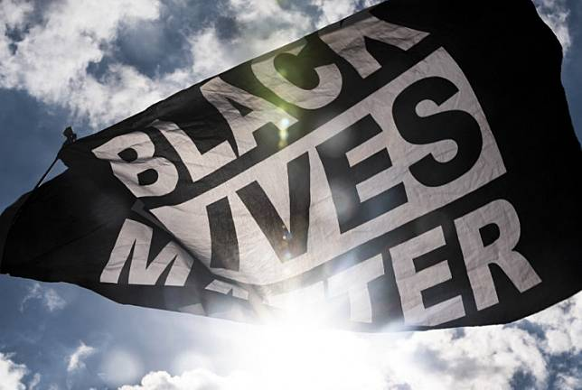 Black Lives Matter flag waves during a demonstration outside the First Police Precinct Station on June 13, 2020 in Minneapolis, Minnesota.