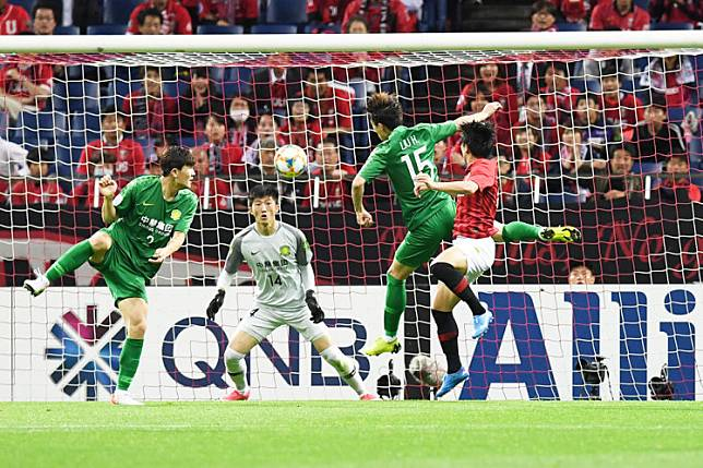 Hard struggle: Urawa Reds' Yuki Muto (right) fights for the ball with Beijing Guoan's Liu Huan during the AFC Champions League Group G match between Japan's Urawa Reds and China's Beijing Guoan in Saitama in this undated file photo. Asia's Champions League is getting closer to a return but it will have to wait until domestic competitions are back in action, a senior football official told AFP on Wednesday.