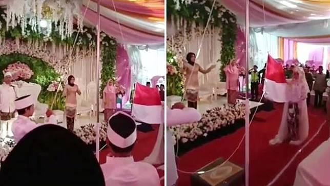 pengantin kibarkan bendera