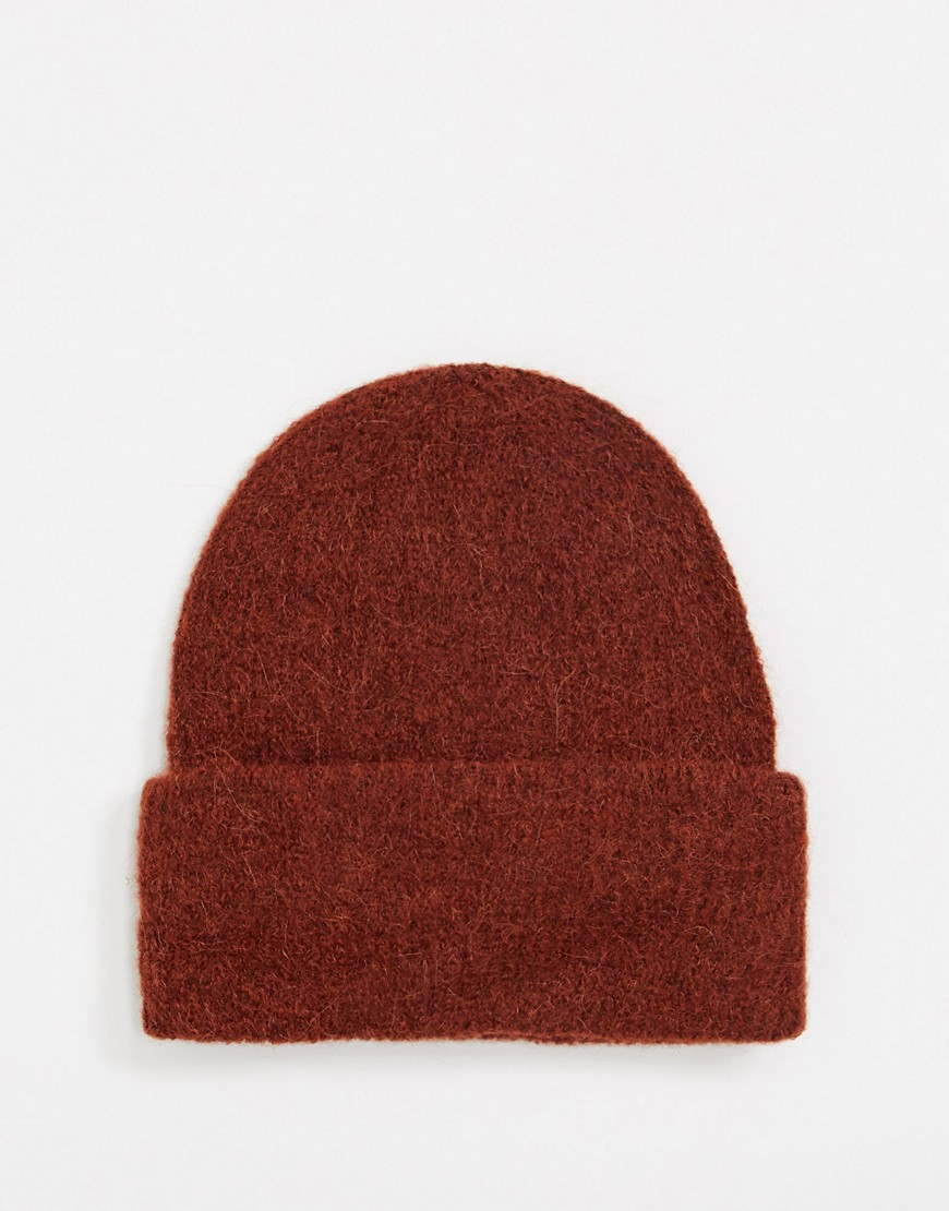 Hat by PIECES Cosy never looked so good Plain design Domed crown Turn-up brim