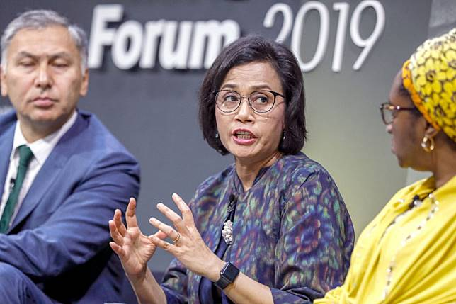 Finance Minister Sri Mulyani Indrawati (center) speaks while flanked by Yerlan Syzdykov (left), the global head of emerging markets at Amundi Asset Management, and Zainab Ahmed, Nigeria's former finance minister, during the 2019 Emerging + Frontier Forum at Bloomberg's European headquarters in London in June 2019.