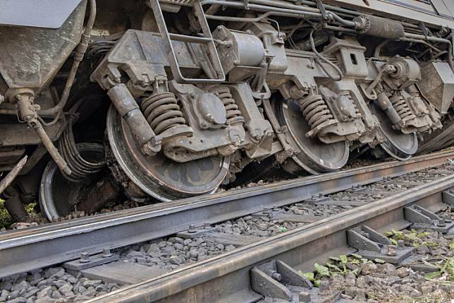One person was killed and 127 injured when a passenger train derailed in central China on Monday after striking debris from a landslide that had fallen to the track, the state-run railway system said.
