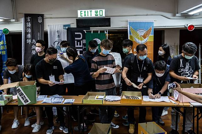 Volunteers counts ballots in Hong Kong on June 20, 2020, following a vote organized by selection of pro-democracy unions to ask members if they will participate in a city wide strike and if they supported China's plans to impose a new national security law in Hong Kong.