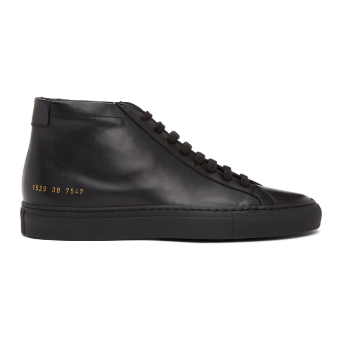 Mid-top buffed leather sneakers in black. Round toe. Tonal Lace-up closure. Padded tongue and collar