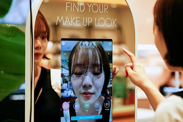 A woman shops using AR make up at a cosmetic shop in a department store in Seoul, South Korea, on July 2, 2020.