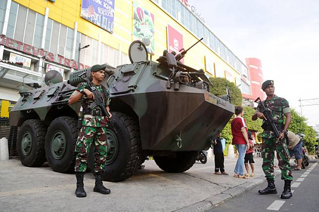 Indonesian Military (TNI) soldiers stand guard in Glodok, West Jakarta, in this file photo.