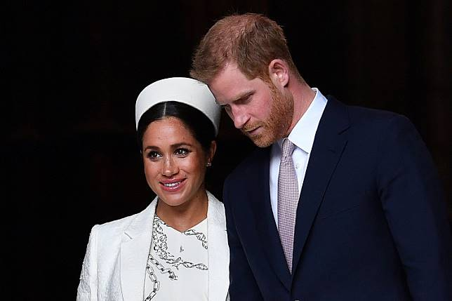 In this file photo taken on March 11, 2019 Britain's Prince Harry, Duke of Sussex and Meghan, Duchess of Sussex leave after attending a Commonwealth Day Service at Westminster Abbey in central London.