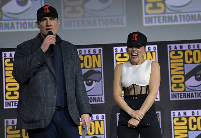 President of Marvel Studios Kevin Feige (L) and US actress Scarlett Johansson speak on stage for the Marvel panel in Hall H of the Convention Center during Comic Con in San Diego, California on July 20, 2019.