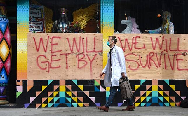 Stuart Malcolm, a doctor with the Haight Ashbury Free Clinic visits homeless people to talk about coronavirus (COVID-19) on the street in the Haight Ashbury area of San Francisco California on March 17, 2020.