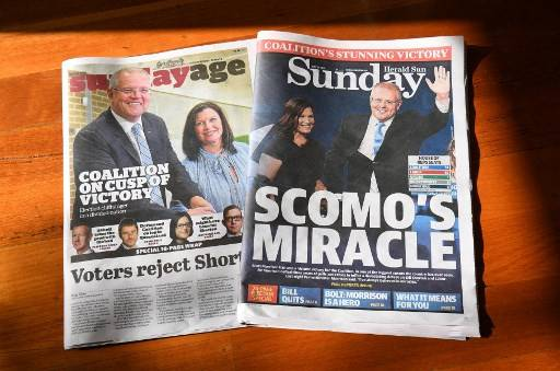 This photo illustration taken on May 19, 2019 show Sunday newspapers in Melbourne displaying the victory of Australia's coalition government after they clung to power in a general election they were expected to lose. Australia's ruling conservative coalition defied expectations to retain power in national elections on May 18, prompting Prime Minister Scott Morrison to declare: