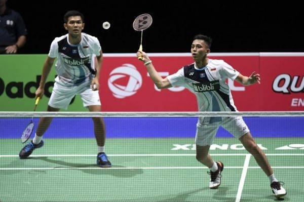 Ganda putra Indonesia Muhammad Rian Ardianto (kanan) dan Fajar Alfian melaju ke babak 16 besar Kejuaraan Dunia Bulu Tangkis 2019.