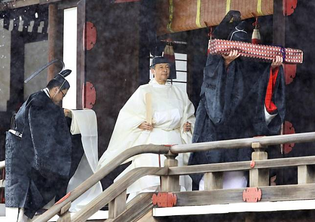 Japan's Emperor Naruhito walks after a ritual called Kashikoro-omae-no-gi, a ceremony for the Emperor to report the conduct of the Enthronement Ceremony at the Imperial Sanctuaries, at the Imperial Palace in Tokyo, Japan October 22, 2019