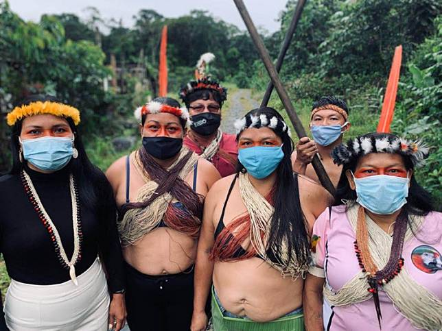 Handout photo released by the organization Amazon Frontlines of Waorani indigenous leaders Nemonte Nenquimo (left) and others before a virtual press conference in Shell, Ecuador, on May 21, 2020. The confederation of Amazon Indigenous People of Ecuador demanded efficient assistance from the government due to the new coronavirus, which according to them, has infected 73 people and killed five in their communities.