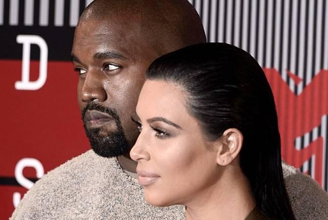 Kanye West dan istrinya Kim Kardashian.