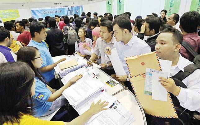 Unemployed young people attend a job fair in Jakarta.