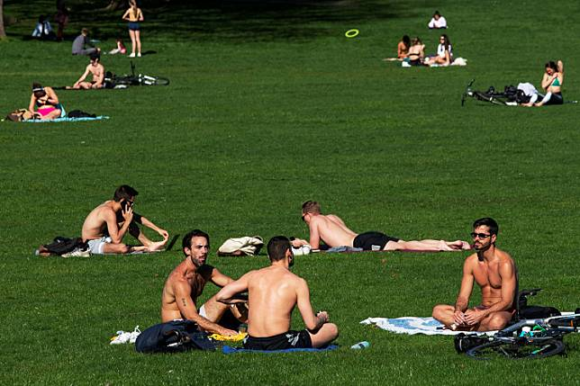 People try to keep a social distance while they enjoy a sunny day outside, as the outbreak of coronavirus disease (COVID-19) continues, in the Manhattan borough of New York City, New York, US, on Monday.