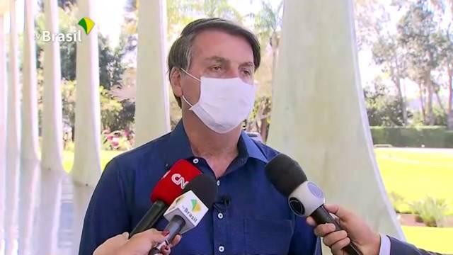 Brazil's President Jair Bolsonaro confirms positive coronavirus diagnosis as he speaks to the media in Brasilia, Brazil on Tuesday in this still image taken from video.