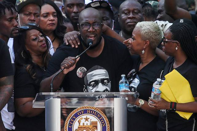 Philonise Floyd, brother of George Floyd, who died in Minneapolis police custody, is surrounded by family members as he speaks at a protest rally against his brother's death, in Houston, Texas, US, on Tuesday.
