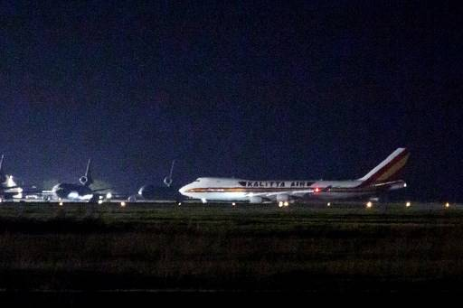 A plane carrying American passengers, who were recently released from the Diamond Princess cruise ship in Japan, arrives at Travis Air Force Base in California on February 16, 2020. The charter flight touched down at the base 40 miles (70 kilometers) northeast of San Francisco, an AFP photographer saw. The passengers will be quarantined at the base for 14 days.