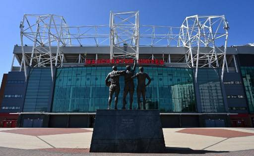 The Old Trafford football stadium complex, home to English Premier League football team Manchester United, is pictured in Manchester, northen England on April 21, 2020, as life in Britain continues during the nationwide lockdown to combat the novel coronavirus pandemic