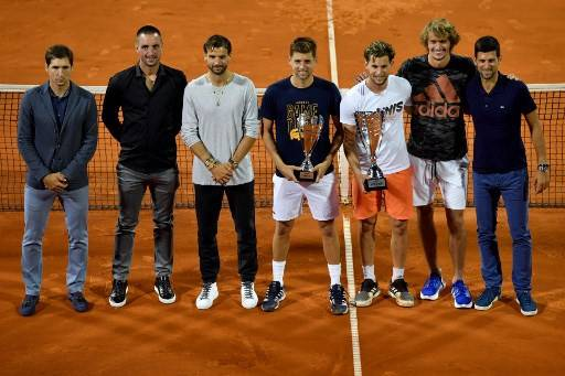 (from left) Serbian tennis player Dusan Lajovic, Serbian tennis player Viktor Troicki, Bulgarian tennis player Grigor Dimitrov, Serbian tennis player Filip Krajinovic, Austrian tennis player Dominic Thiem, German tennis player Alexander Zverev and Serbian tennis player Novak Djokovic pose for a group photo after the final match between Austrian tennis player Dominic Thiem and Serbian tennis player Filip Krajinovic at the Adria Tour, Novak Djokovic's Balkans charity tennis tournament in Belgrade on June 14, 2020. The ATP and WTA Tours have been suspended since March due to the COVID-19 pandemic and will not resume at least until the end of July 2020.
