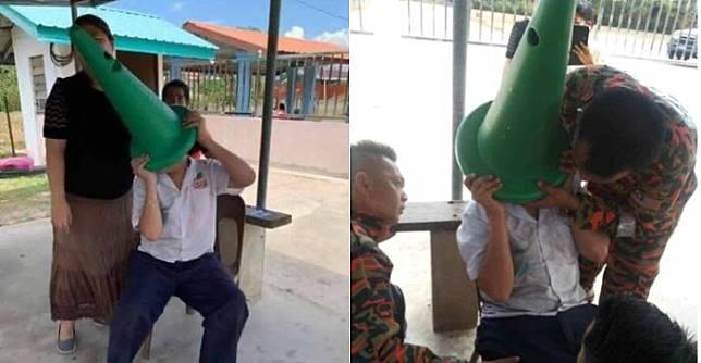 Seorang bocah kelas 5 SD di SJKC tersangkut savety cone setelah iseng memasukkan kepalanya saat menunggu jemputan orang tuanya
