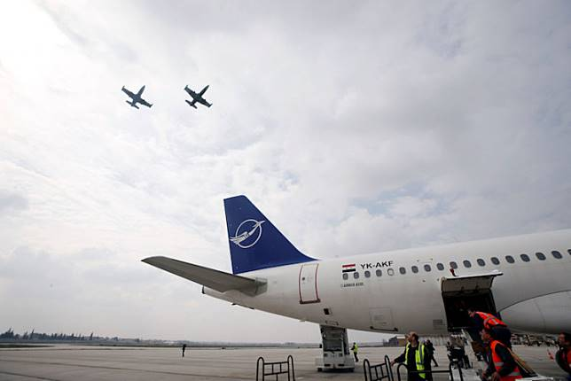 Syrian jets fly in the sky in celebration after a SyrianAir Airbus A320-200 landed at Aleppo International airport that has been reopened for the first time in years, Syria on Feb. 19, 2020.