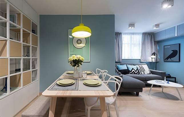 為免牆身過於單調,飯廳除選用方格設計的飾物櫃外,亦以充滿藝術氣息的掛畫粉飾。(受訪者提供)