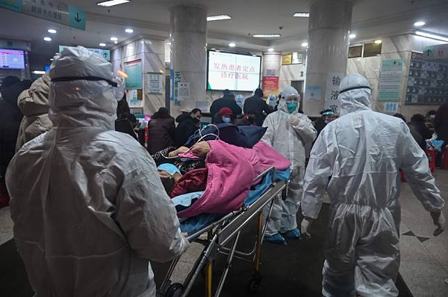 Foreigners pulling out of coronavirus hit Wuhan as death toll rises sharply