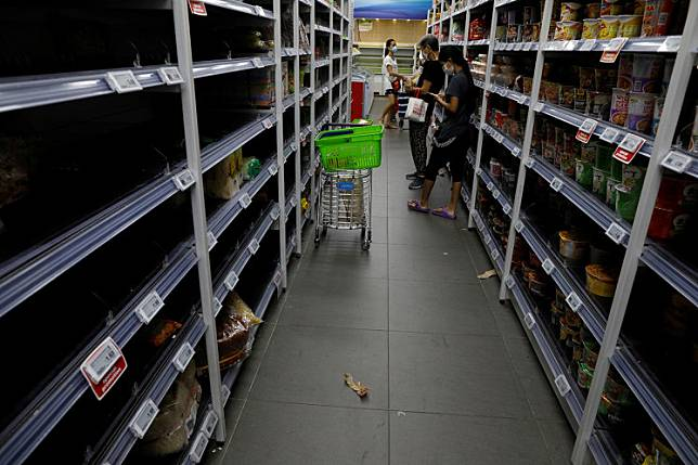 Shelves are seen empty in a supermarket during the outbreak of coronavirus disease (COVID-19) in Singapore, on Friday. Singapore will close schools and most workplaces, except for essential services and key economic sectors, for a month,