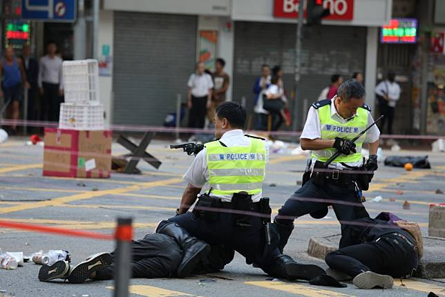 Hong Kong police officer who shot protester receives death threats against children after personal details released online, force says
